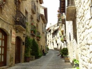 Ainsa's narrow, slanting streets separate tall stone houses