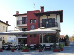 Helianthus guesthouse stands on the main square with an outdoor cafe on Ammouliani island.
