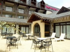Mercure SensOria hotel's outdoor patio in Saint Lary