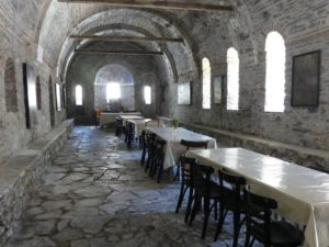 A long hall with a kitchen at one end where monks take their meals.