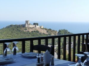 Platamon Castle sits on a green hill top overlooking the sea.New Palaios Panteleimonas in Pieria.