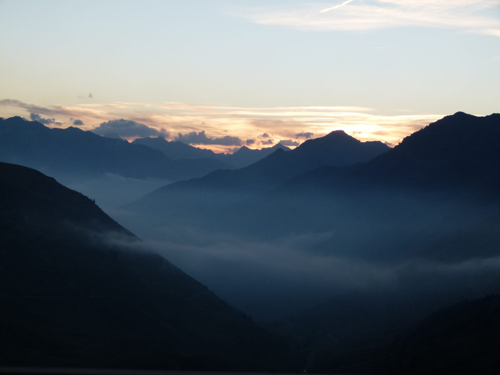 The misty Pyrenees mountain range at dusk