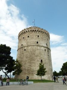 The White Tower on the boardwalk of Thessaloniki is tall and white, with a sordid history.